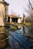 Destroyed and abandoned house is flooded with water royalty free stock photography
