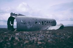 Destroyed Airplane Body on Sea Shore during Daytime Royalty Free Stock Photos