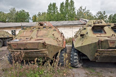 Destroyed armored troop-carrier. Site with damaged armored personnel carriers BTR-60PB Royalty Free Stock Images