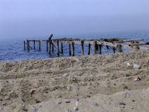 Destroyed bathing jetty. On a beach in Gilleleje - Denmark Royalty Free Stock Photo