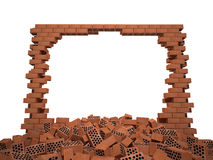 Destroyed brick wall. Hole in the brick wall in front of a pile of red brick Stock Image