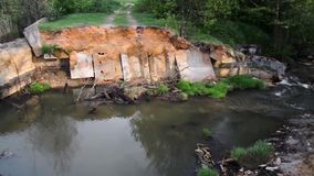 Destroyed bridge dam over the river stock footage