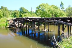 Destroyed bridge. Old wooden destroyed bridge stock image