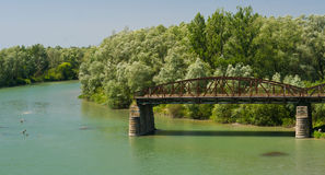 The destroyed bridge and river are Prut Stock Photos