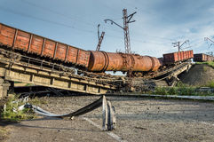 Destroyed bridge with wagons Stock Photography