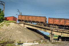 Destroyed bridge with wagons Royalty Free Stock Images