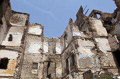 Destroyed building. Demolition, earthquake, bomb, terrorist attack or natural disaster Stock Image