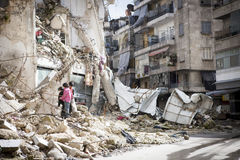 Destroyed building Aleppo. 12/02/13 Aleppo,Syria. One of countless bombed residential buildings in a rebel held area of Aleppo. three children collect firewood