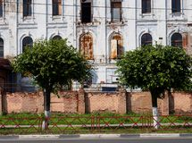 Destroyed building amid trees stock images