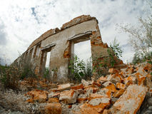 Destroyed building, debris. A destroyed building, can be used as demolition, earthquake, bomb, terrorist attack or natural disaster concept stock photo