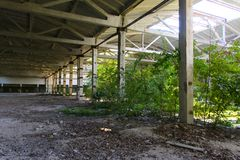 The destroyed building of the factory workshop, which worked Royalty Free Stock Photo