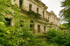 Destroyed building of the Palace. Ruins of the estate in the forest. stock photo