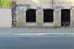 Destroyed building in the street, a lot of copyspace. Royalty Free Stock Images