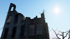 Destroyed building and sunny sky. Low angle shot of the ruined building against bright sunny sky Royalty Free Stock Photos
