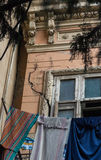Destroyed buildings in Tbilisi. Ruins of old houses in cracks with sagging fosades in Tbilisi Royalty Free Stock Images