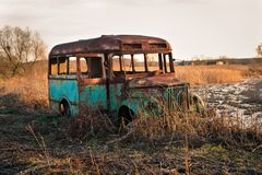 Destroyed bus during sunset stock image