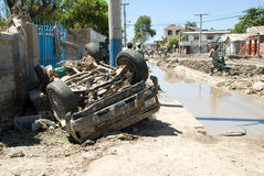 Destroyed Car. September 30, 2008 - A car, destroyed by the effects of Hurricane Ike, clogs the main street in Gonaives, Haiti, weeks after the storm hit Stock Photo