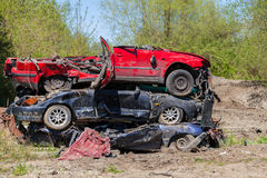 Destroyed cars lying on a pile Royalty Free Stock Images