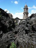 Destroyed cathedral protruding from lava royalty free stock photo