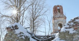 Destroyed church against the background of dry trees and sun.  stock video footage