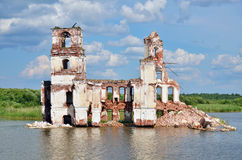 Destroyed church on the lake. In Russia Stock Photos