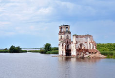 Destroyed church on the lake in Russia Stock Images