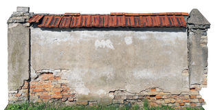 The destroyed clumsy ugly brick fence fragment. Royalty Free Stock Image
