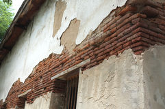 Destroyed concrete and brick wall on old building Royalty Free Stock Photo