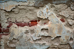 Destroyed Concrete and Brick wall. Wall with bricks half covered with paint. Stock Photos