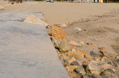 Destroyed and covered with sand road on the beach. Destroyed from the waves  road on the beach Stock Photography