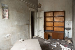 Destroyed desk and book shelf in the principla's office. Are seen in an old school building Sofia, Bulgaria, May 12, 2014. Some of the doors and windows had Stock Photo
