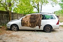 Car used to sleep by people without a home. Destroyed and dismembered car used for living and sleeping by people without a home Stock Images
