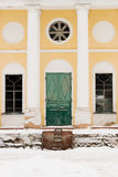Destroyed entrance to the Russian church. Russian temple doors and white walls in sunny day. Destroyed entrance to the Russian church Stock Images