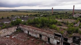 Destroyed factory, trees on the roof, aerial view stock video