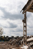 Destroyed factory building and rubble - industrial background. With cloudy sky stock image
