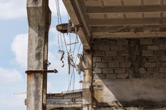 Destroyed factory building. With some wires hanging from the roof stock photo