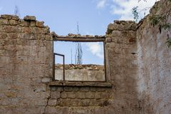 DESTROYED FORMED OLD ADMINISTRATIVE HOUSE IN THE CITY ENVIRONMENT. Royalty Free Stock Photo