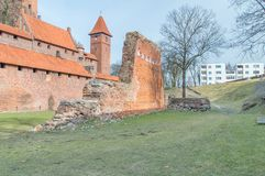 Destroyed fortification wall near high Castle of Castle of the Teutonic Order in Malbork. stock photos
