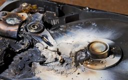 Destroyed hard drive in close up view Stock Photos