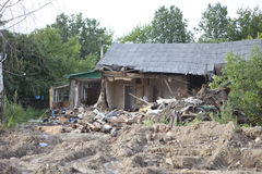 Destroyed house. An old building being destroyed with lot`s of debris Stock Photo