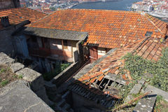 Destroyed house roofs. Destroyed red roofs of houses with broken balconies, Porto, Portugal Royalty Free Stock Image