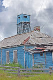 The destroyed house and watchtower. Solovki islands, Russia Royalty Free Stock Images