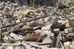Disaster scene full of debris, dust and damaged house. stock photo