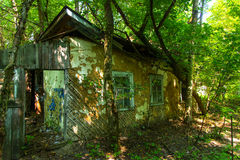 Destroyed houses in which people lived. In a dead radioactive zone. Consequences of the Chernobyl nuclear disaster and vandalism, August 2017 Stock Image