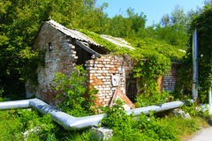 Destroyed houses in which people lived. In a dead radioactive zone. Consequences of the Chernobyl nuclear disaster and vandalism, August 2017 Royalty Free Stock Image