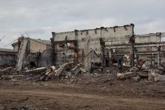 Destroyed industrial buildings, can be used as demolition, war, bomb, terrorist attack, earthquake or any other disaster concept. Destroyed industrial buildings Stock Photo