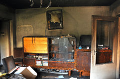 Destroyed interior of a house after a fire. Ruins of a destroyed residence after a house fire Royalty Free Stock Image