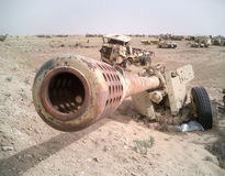 Destroyed Iraqi Armor in Kuwait. This stock photo depicts the barrel of a destroyed Iraqi artillery piece along with many other Iraqi trucks and vehicles all Stock Image