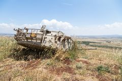 Destroyed Israeli tank is after the Doomsday Yom Kippur War on the Golan Heights in Israel,  near the border with Syria. Destroyed Israeli tank is after the Royalty Free Stock Photo