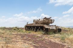 Destroyed Israeli tank is after the Doomsday Yom Kippur War on the Golan Heights in Israel,  near the border with Syria. Destroyed Israeli tank is after the Stock Photography